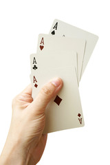 Hand Holding Four Aces On White Background