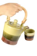 Tea pot in hand