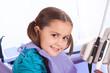 pretty little girl in dental office waiting for the dentist