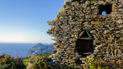 Ruins in a Corsican landscape (France) - evening light and sea