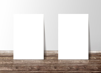 Two blank white paper template banners on the wooden floor again