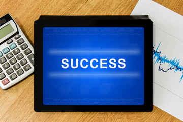 success word on digital tablet