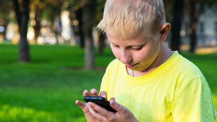 boy with smatphone outdoor
