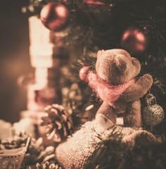 Christmas still life with teddy bear decorating tree