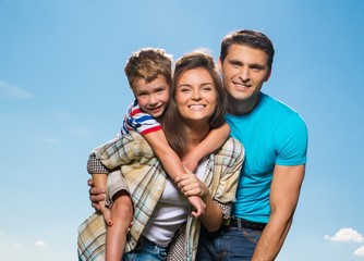 Happy young family with their child outdoors