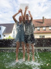 Two girls making ice bucket challenge