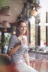 Young woman drinking milkshake