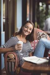Young woman drinking milkshake