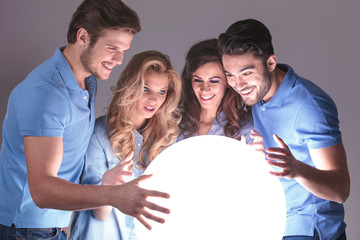 laughing group of friends reading in a crystal ball