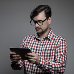 Handsome hipster modern man using tablet.
