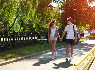 Urban young couple in love walking in sunny summer day, youth, l