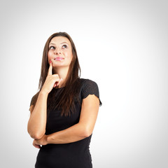 Pensive woman over vignette background