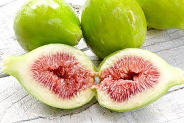 ripe figs close up over white wood