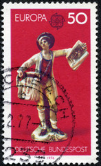 stamp printed in Germany shows Boy selling copperplate prints