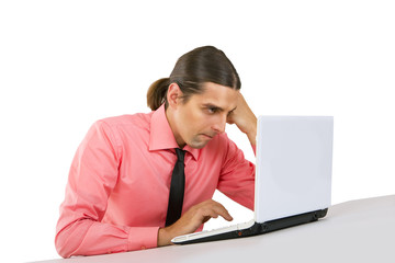 Angry grumpy Young man with laptop looking at the monitor over w
