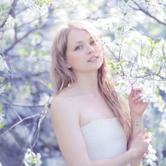 Portrait lovely cute girl in a spring garden