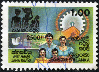 stamp printed in the Ceylon shows image of a family members