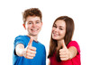 Teenage girl and boy showing OK sign isolated