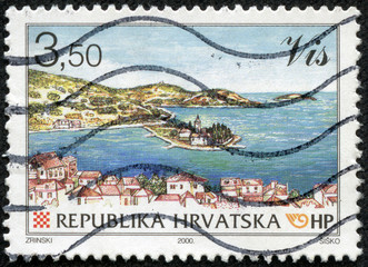 stamp from Croatia shows image of a coastal landscape