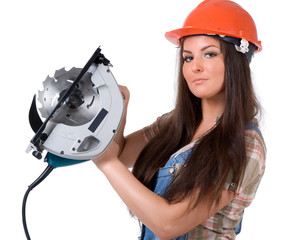 Young woman holding an electric circular disk saw.