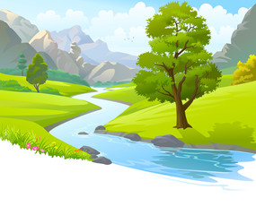 River flowing through mountains and scenic green fields