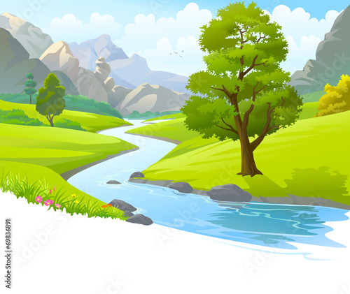 River flowing through mountains and scenic green fields - 69836891