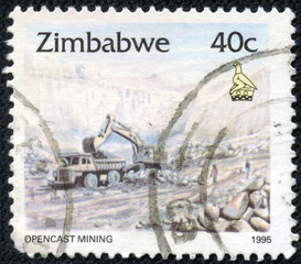stamp printed in Zimbabwe shows excavation, opencast mining