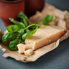 Italian Parmigiano-Reggiano cheese with basil