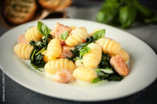 Italian gnocchi pasta with salmon and fresh basil - 69837045