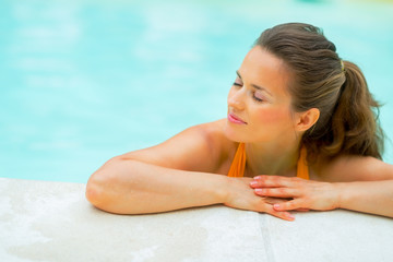 Portrait of relaxed young woman in swimming pool