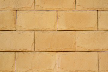 wall of yellow brickwork close-up abstract background