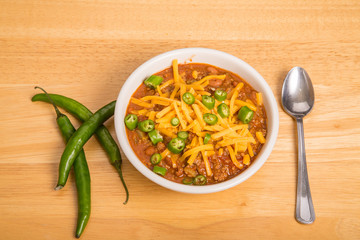 Bowl of Chili with Cheese and Sliced Peppers