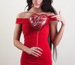 Girl in red with a ball in the shape of a heart