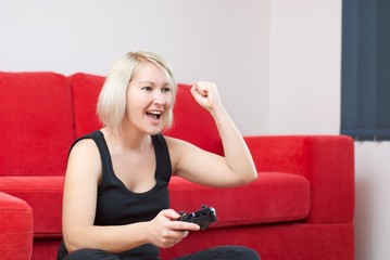 Blonde girl is winning at video games