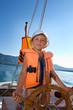 little boy at sail boat wheel
