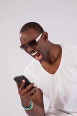 Black man yelling on his cell phone