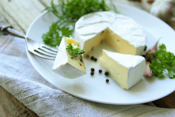 Camembert cheese on a white plate for appetizer