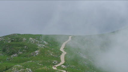 Path in the mountains with fog.