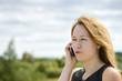 Beautiful caucasian girl talking to smart phone