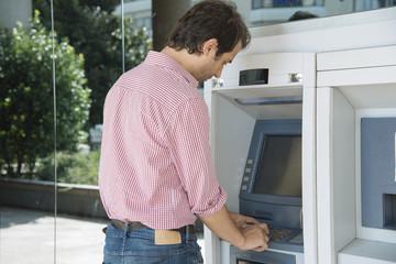 man atm cash withdraw
