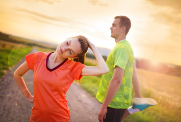 Running couple stretching