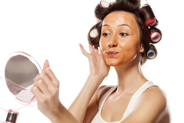 girl with curlers and with wrong liquid foundation on her face