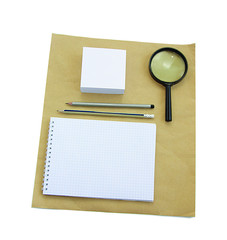 Paper notebook and magnifying glass.