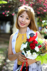 Young beautiful asian woman hold flower
