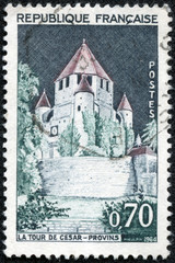 stamp printed by FRANCE shows view of the Caesar Tower