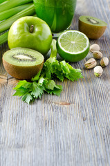 Healthy green food ingredients for smoothie copy space
