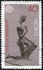 stamp printed in the Germany shows Kneeling Woman