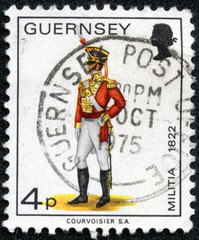 stamp printed in Guernsey shows military officer