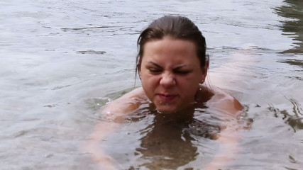 Girl flops into in sea