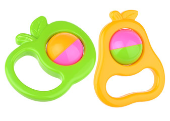 colorful baby rattles on white horizontal background